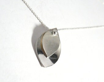 Crew necklace with handcrafted bi-texture pendant in sterling silver