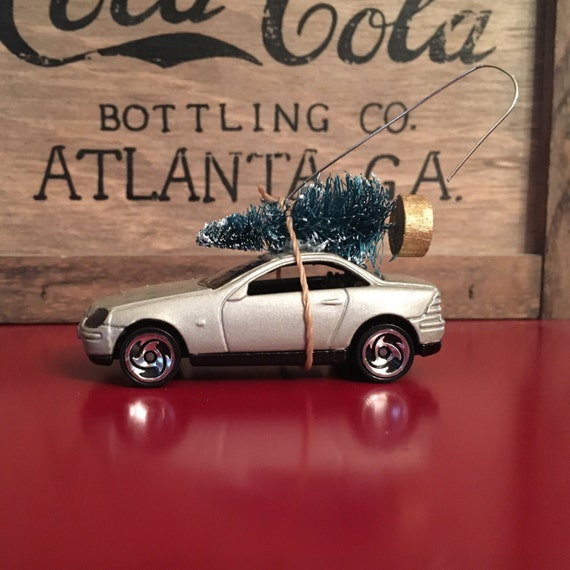 Mercedes carrying christmas tree ornament for Mercedes benz christmas ornament