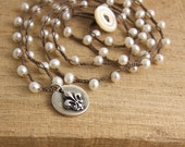 Special Order Crocheted Necklace with Brown Cord, Pearls and a Round Pendant with a Fleur De Lis Design 32 inch length