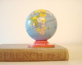 Vintage Ohio Art globe bank, tin toy bank, 1970 history and geography, collectible world globe, mid-century decor