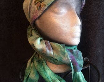 Hand dyed silk double layered triangle scarf with a nuno felted and top stitched with starfish sari silk