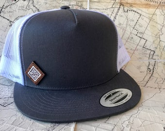 Hand panted wooden patch snapback trucker hat