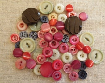 Vintage colored mother of pearl and glass assorted size and round self shank sew hole buttons. Lot of 55 bttons.
