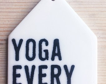 porcelain wall tag screenprinted text yoga every day.
