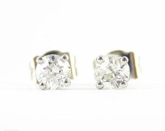 Old European Diamond Stud Earrings. Antique Half Carat 0.50 ctw Diamonds Set in Modern 4 Claw Basket Platinum Mounts.