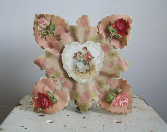Large antique valentine stand up 3D riveted valentine unused in original box Geo C Whitney Co number 674 blush pink roses red roses kitten