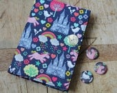 Pink unicorn fabric covered notebook & badge set.  Removable cover