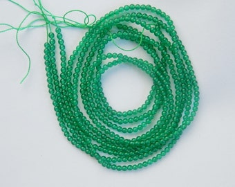 2.4 mm    Green Onyx smooth   round beads (full strand, 16 inches)