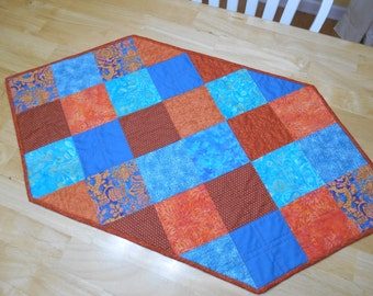 Festive hand-quilted modern table runner in turquoise and orange