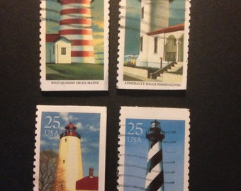 Four (4) Recycled Postage Magnets: Lighthouse, Sandy hook New Jersey, admiralty head, cape hatteras, west quoddy head Maine