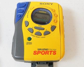 Vintage Sony Walkman Sports WM-FS493 Cassette AM/FM Mega Bass Weather Proof Works Yellow
