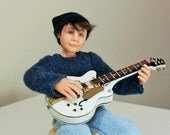 Josh playing guitar, hand sculpted miniature dollhouse doll in 1/12th, one inch scale, ooak by Jendlewick Dolls