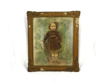 ON SALE Antique 19th century sepia studio photograph portrait of little girl in gilt frame with convex glass.