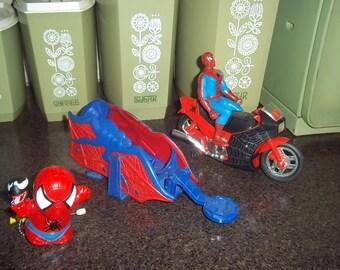 Large lot of Marvel's Spiderman action figure, web slinger holder and vehicle