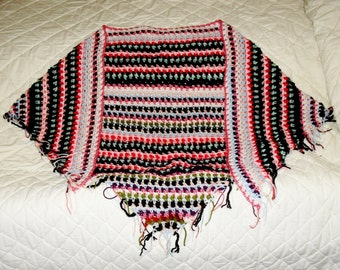 Hand crocheted fringed shawl