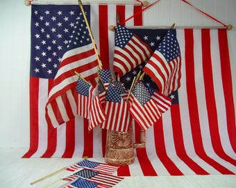 American Flags Collection of 16 Vintage Well Used Displayed Naturally Aged Fabric USA Flags on Wooden Poles Variety of Condition & Sizes Set