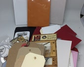 Scrapbook embellishments, paper pockets, brown paper bags and more