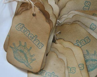 gracias. blue sea sheall. spanish thank you. coffee stained tags. hangtags. distressed shabby chic . primitive.