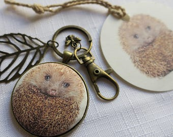 Hedgehog and bee key ring or pendant with matching tag. Mum charm if needed. Donation The British Hedgehog Society. Silver / antique bronze.