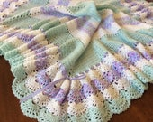 "36"" x 54"" baby blanket with shell body and three colors in edging."