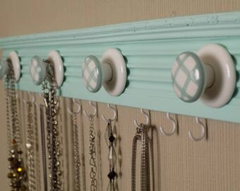 Sea green Jewelry  rack with 4 gingham knobs and  11 additional hooks on fluted moulding 23  inches long