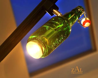 Track light; Green glass beer bottle; Swing-top cap.