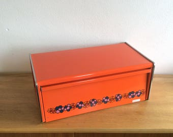 Seventies orange Brabantia Diana square shouldered bread box with floral motif and chrome trim. Retro bread box.