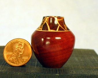 Random Segmented Woods on Red Ivorywood Turned Miniature Pot