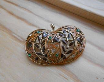 Vintage pumpkin brooch.  Gold with enamel and rhinestones.