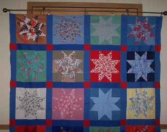 Beautiful vintage quilt top. Mostly hand stitched star pattern.