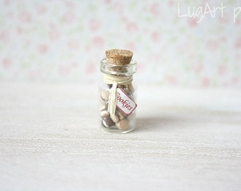 Jar with tiny cookies for dollhouse scale