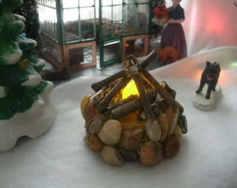 Miniature fairy village fire pit campfire tealight flickers like a real fire has a yellow glow