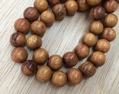 Robles Wood Beads, Brown, 10mm Round - 15.5 inch Strand - eW684-10