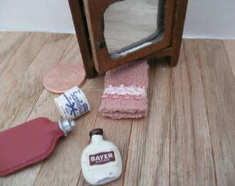 Doll House scale of 1 to 12 Bathroom Mirror Cabinet and Supplies, Towel, Hot Water Bottle, Bayer Aspirin Bottle and ScotTissue, Toilet Paper