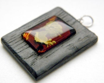 SALE 20% OFF!!! Use the coupon code: SALE20 Black oak hand carved baltic amber camea pendant