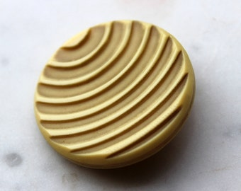 vintage celluloid button. large 1 1/2 inch diameter.carved  grooved planetary design. vintage and modern ! 1920's sewing supply