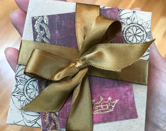 Gift wrapped with ribbon/paper flower/or gift card