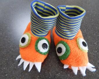 Orange and green fleece monster stay on baby booties