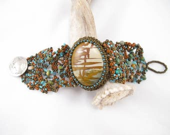 Bracelet-statement jewelry-picture jasper cabochon-earthy colors-natural stone-seed beads-turqoise-Indian head nickel-bead embroidered