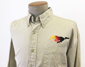 1980s Ford Mustang Men's Vintage Khaki Long Sleeve Team Mustang Uniform Long Sleeve Shirt by Munsingwear - Size MEDIUM