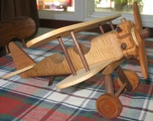 Solid wood bi-plane made with five different hard woods, hand made, each one unique.