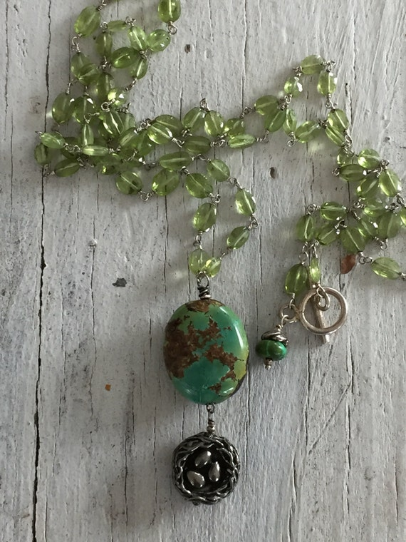 Home.  Peridot wire wrapped chain with turquoise bead and Green Girl nest. Handmade and OOAK from ladeDAH!