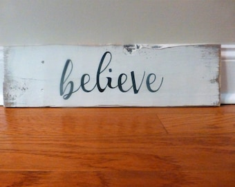 Believe sign, hand painted on weathered, reclaimed wood