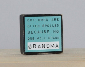 CHILDREN are often SPOILED because no one will spank GRANDMA - Wood Block