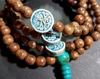 108 ct. 6mm Old Soil Agarwood Mala with Ceramic Tree of Life Markers and Kingman Turquoise Guru Bead