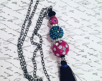 """Wire wrapped carnival beads with black tassel on 30"""" black copper chain."""