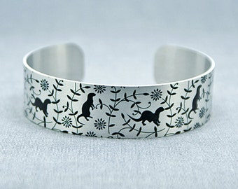 Otter jewellery cuff bracelet, brushed silver with black otters. Recycled jewellery. Otter gifts, wildlife animals. Secret message. B480