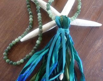 Sari Silk Fringe Necklace is a simple, over-the-head pour of green quartz beads and a luxuriant silk tassel tied up by leather and shells.