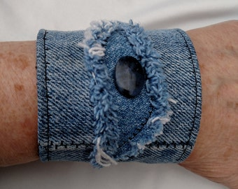 Denim jewelry bracelet, upcycled from stonewashed jeans, metal button, denim cuff, dumortierite stone on panel, handmade denim jewelry