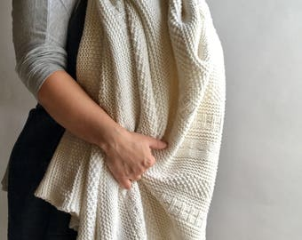 Soft spun White Cotton Afghan Blanket / White Throw Blanket Knitted by the Folk Crafts Guild of The Lion Knitting Mills in Cleveland, Ohio.